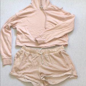 Blush cropped hoodie, shorts, matching set.